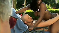 Jada Fire gets her big black ass groped by a white dude outdoors